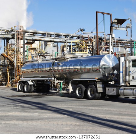 Tanker truck being loaded at a factory - stock photo