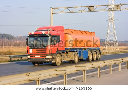 "tanker truck on industrial road of my ""business vehicles"" series - stock photo"