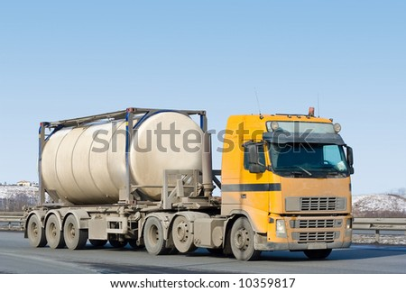 """tanker truck on industrial road  - See similar images of this """"Business vehicles"""" series in my portfolio - stock photo"""
