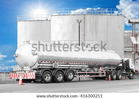 Tanker Truck to transport fuel in industrial petroleum plant - stock photo