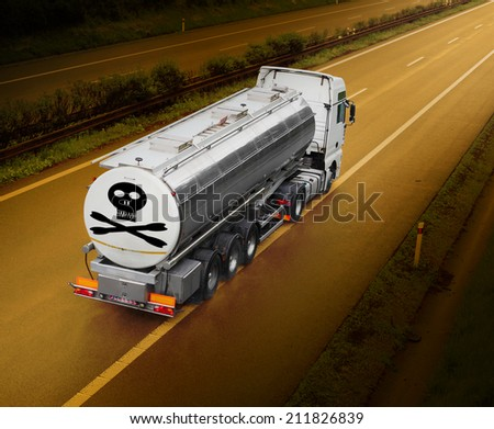Tanker truck with toxic content riding on the highway. - stock photo