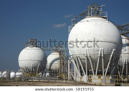 tanks in oil refinery factory - stock photo