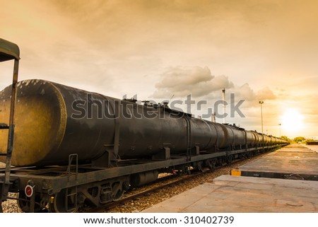 Tanks with fuel being transported by rail - stock photo