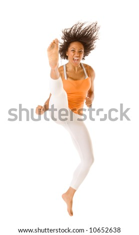 Tanned fit sporty female jumps and kicks - stock photo