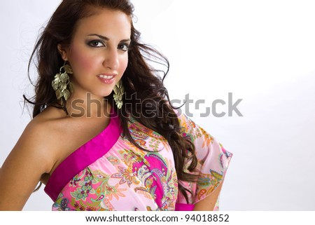 Tanned woman in floral medium dress