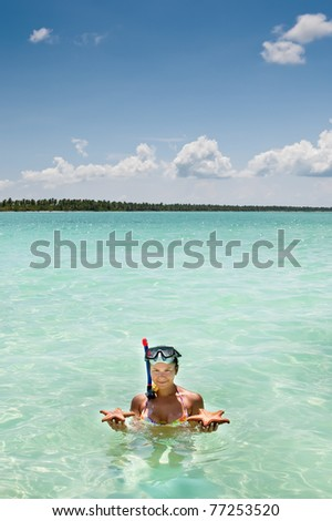 Tanned women hold in hands starfish ocean summer