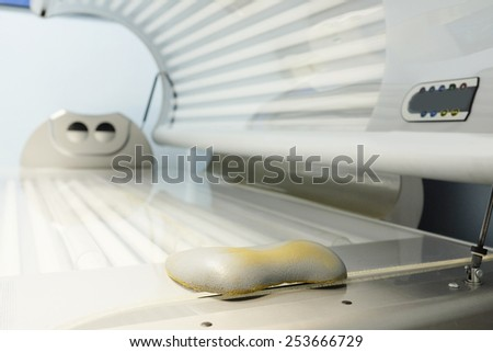 Tanning bed in a salon - stock photo