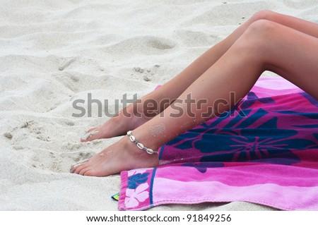 Tanning on the beach - stock photo