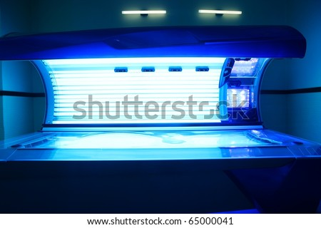 Tanning solarium light machine blue color glowing - stock photo