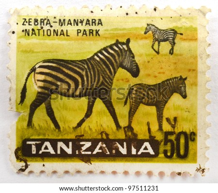 TANZANIA - CIRCA 1965: A stamp from Tanzania shows image of zebras in Manyara National Park, circa 1965 - stock photo