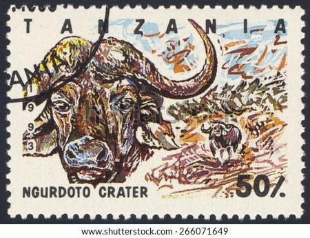 TANZANIA - CIRCA 1993: A stamp printed in Tanzania dedicated to Ngurdoto crater, shows buffalo, circa 1993 - stock photo