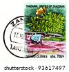 TANZANIA - CIRCA 2011: A stamp printed in Tanzania shows drying cloves process, circa 2011. - stock photo
