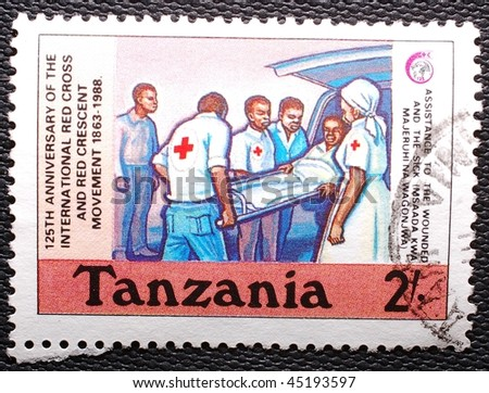 TANZANIA - CIRCA 1988: A stamp printed in Tanzania shows image of a patient being stretchered into an ambulance, circa 1988 - stock photo