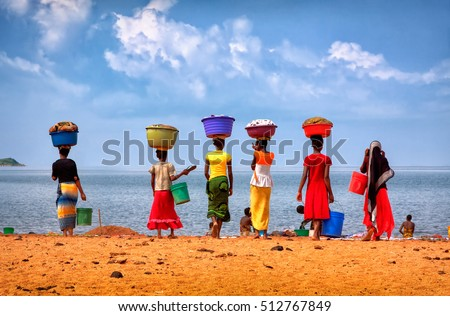 Tanzania, Tanganyika lake, January'28'12 .The women came to the laundry to the lake Tanganyika