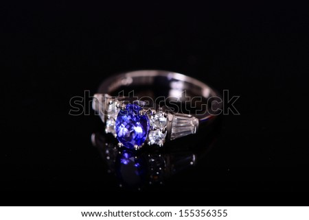 Tanzanite And Diamond Platinum Ring isolated over black