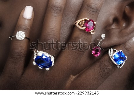 Tanzanite, Rubellite and Diamond,s Designer Jewellery on the Skin of a Black Lady - stock photo
