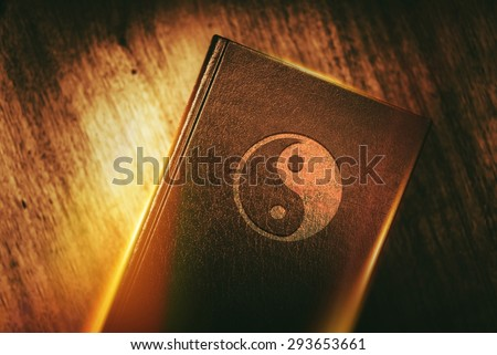 Taoism Book of Harmony. Taoism Also Called Daoism is a Philosophical, Ethical or Religious Tradition of Chinese Origin. Taoism Symbol on the Book Cover. - stock photo
