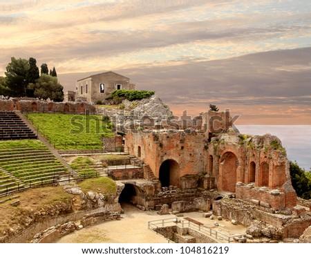 Taormina Greek Amphitheater Ruins at Sunset - stock photo