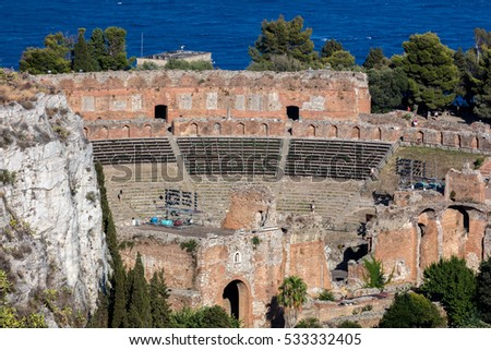 TAORMINA, ITALY - AUGUST 19 2016: The Ancient theater of Taormina, Sicily, Italy, built by the Greeks around the third century BC, then renovated and expanded by the Romans
