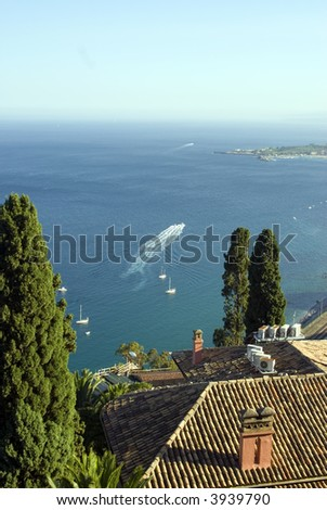 taormina italy sicily view of bay of taormina and architecture with cruise and sail and yacht boats ships