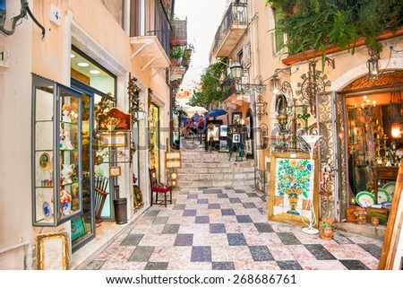 TAORMINA, SICILY - SEP 17, 2014: Tourists art corner near to the City centre on Sep 17, 2015 in Taormina, Sicily. Italiy. - stock photo