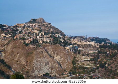 Taormina stands high on cliff overlooking Mediterranean Sea