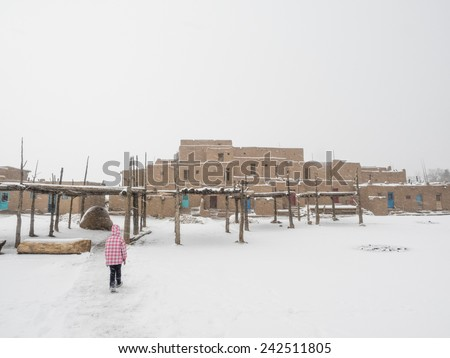 Taos Pueblo is an ancient pueblo belonging to a Tiwa-speaking Native American tribe of Pueblo people. - stock photo