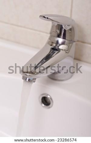 tap in the bathroom - stock photo