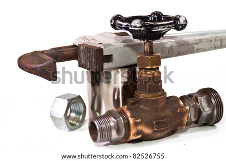 tap water, a pipe wrench on the pipe and the nut on a white background - stock photo