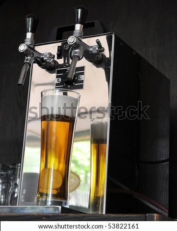 tap with beer - stock photo