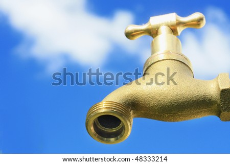 tap with sky background - stock photo