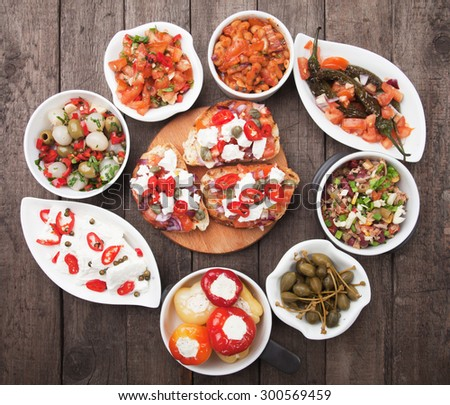 Tapas, antipasto or meze, traditional mediterranean cold buffet food - stock photo