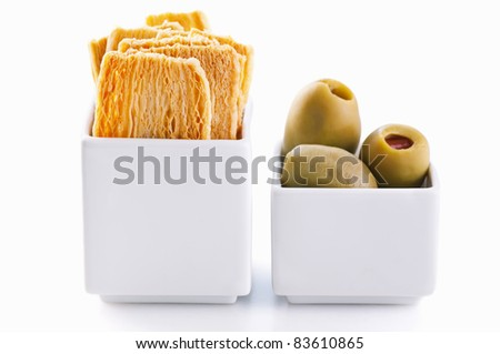 Tapas cracker with pickle olives - stock photo