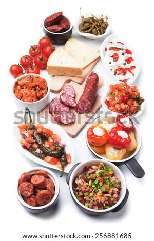 Tapas or antipasto food, mediterranean cold buffet isolated on white background - stock photo