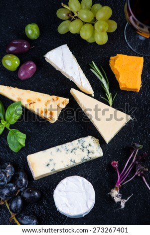Tapas style board with cheese,olives and wine and fresh grapes - stock photo