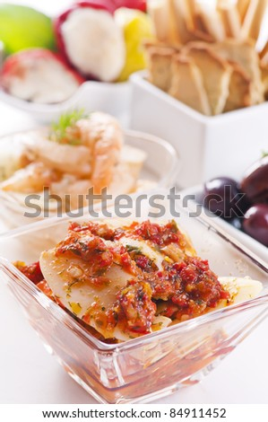 Tapas with pickled seafood and olives - stock photo