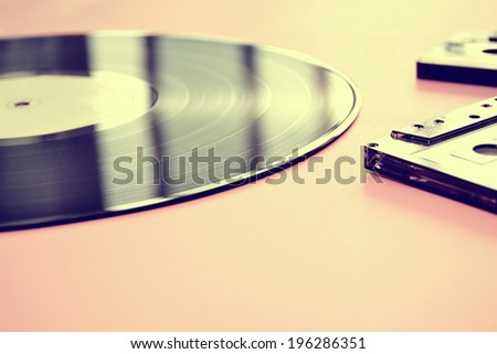 Tape cassette and vinyl record vintage - stock photo
