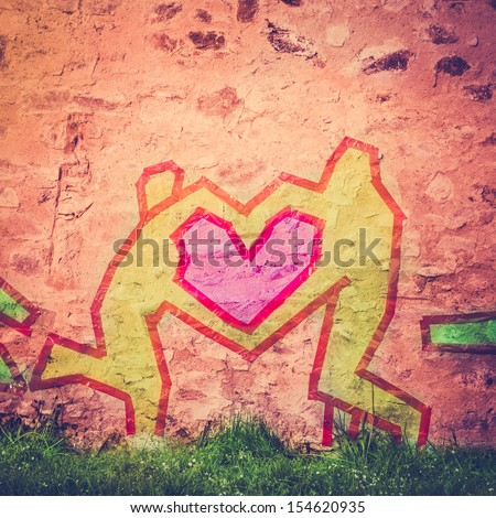 Tape Figures Forming a Heart as a Love Symbol on a City Wall - stock photo