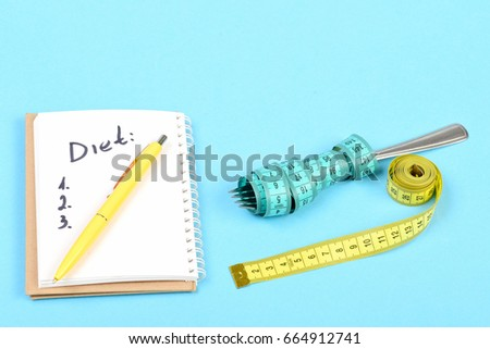 Tape for measuring in yellow colour and cyan blue one wrapped around fork near notebook with diet checklist and yellow pen on it, isolated on light blue background