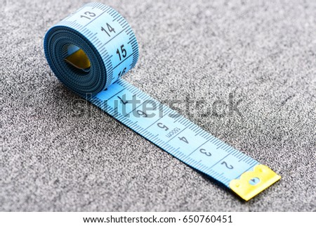 Tape measuring on light grey background stock photo royalty free tape for measuring on light grey background concept of accuracy and metering aloadofball Images