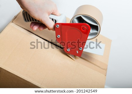 tape gun dispenser - stock photo