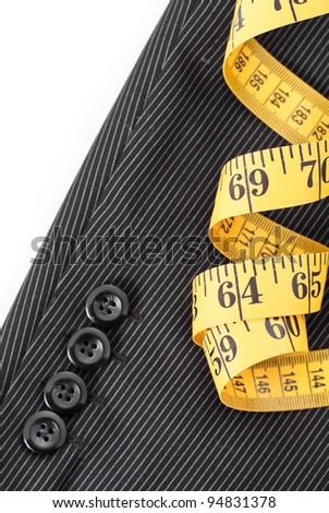 Tape Measure on Business suit Sleeve - stock photo