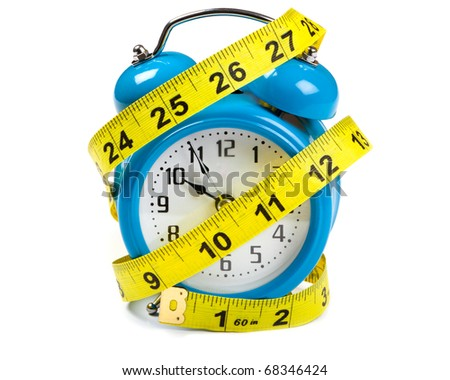 Tape Measure  wrapped around a blue alarm clock - stock photo
