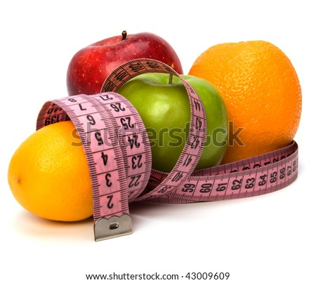 tape measure wrapped around fruits isolated on white background