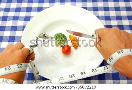Tape measure wrapped around hands - stock photo