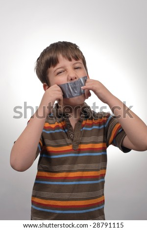 Tape on a loud little boy mouth - stock photo