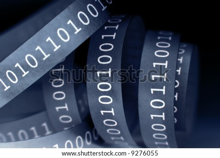 Tape with binary code close-up. Shallow DOF. - stock photo
