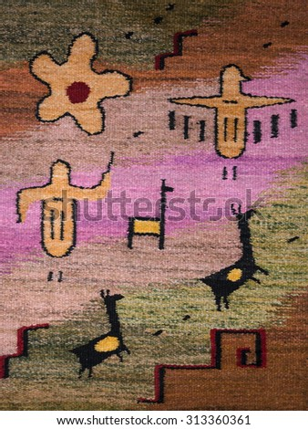Tapestry representing ancient cave painting symbolizing a group of American animals - stock photo