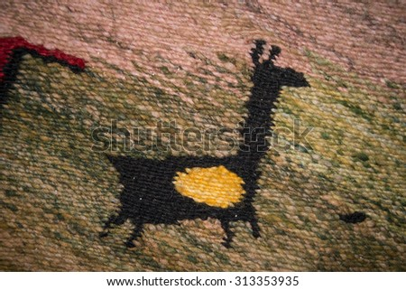 Tapestry representing ancient cave painting symbolizing a llama - stock photo