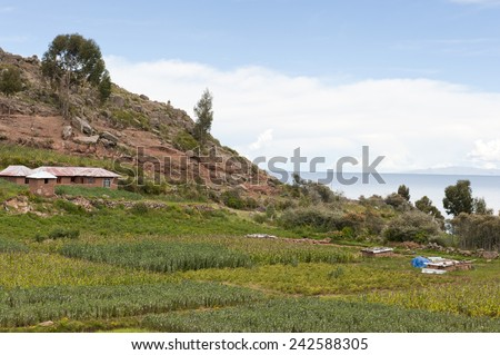 Taquile is an island on the Peruvian side of Lake Titicaca 45 km offshore from the city of Puno.  - stock photo